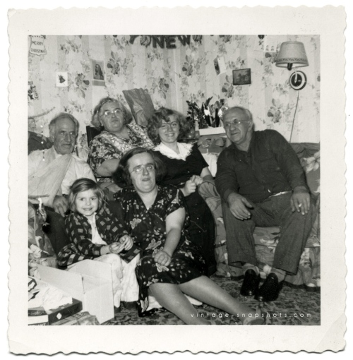 Vintage photo of a family at home at Christmas