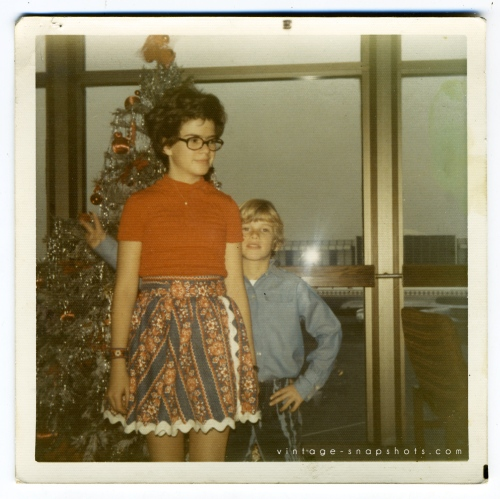 Vintage 1970s color snapshot of 2 kids at Christmastime