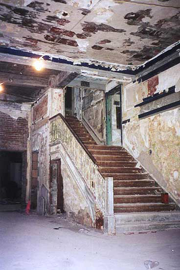 The staircase in the lobby of the Madison Theatre in ruins before demolition