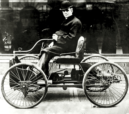 Early Ford automobile, the quadricycle, with Henry Ford driving