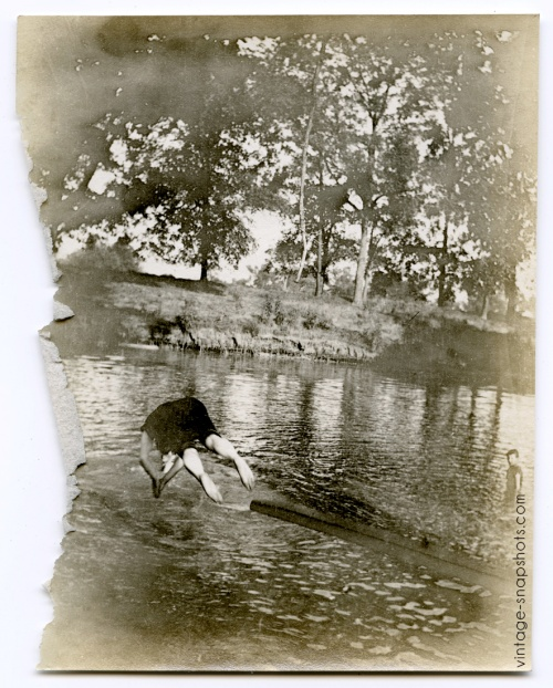 Vintage photo of a person diving into a lake, circa 1905