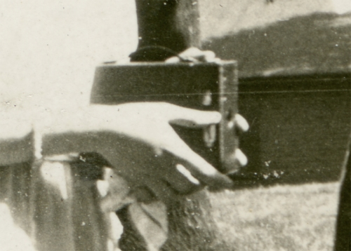 Detail of woman holding a Kodak Brownie camera