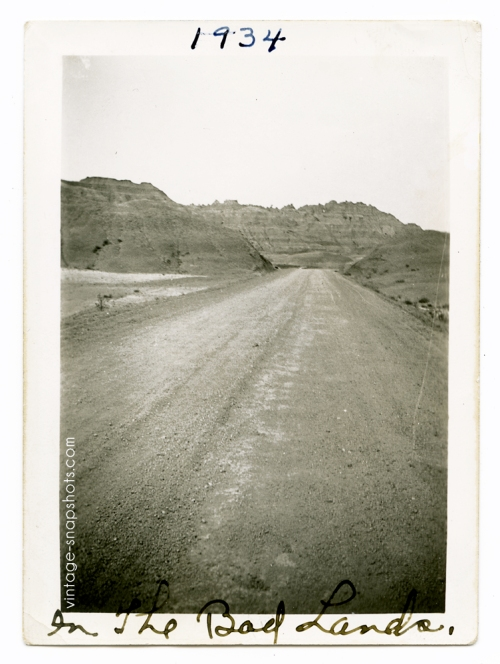 Vintage '30s snapshot of lonesome road in The Badlands