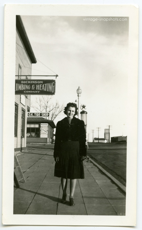 Vintage snapshot of woman on the street in small town in North Dakota