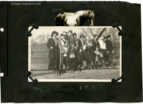 Photo album page containing vintage snapshot of women with a cut-out horse pasted above