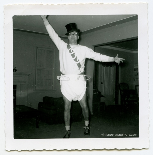 Vintage 1959 snapshot of man celebrrating New Year's in 1959 by wearing a giant diaper
