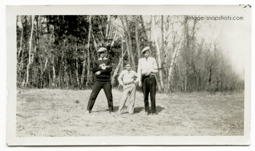 Odd vintage snapshot of two brothers flanking a small guy with a pistol pointed at him. Circa 1920s