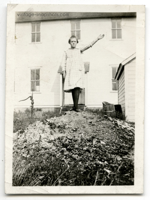 "Vintage circa 1920s snapshot of girl standing on top of small ""hill"""