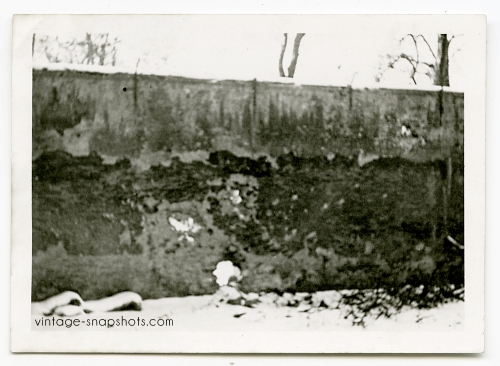 Vintage snapshot photo of a wall against which German soldiers in WWII executed prisoners