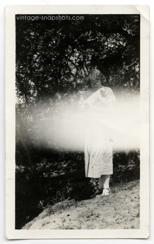 vintage-1920s-snapshot-dog-woman-light-leak