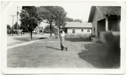 1940s/'50s snapshot photograph of black boy in baseball pitching pose